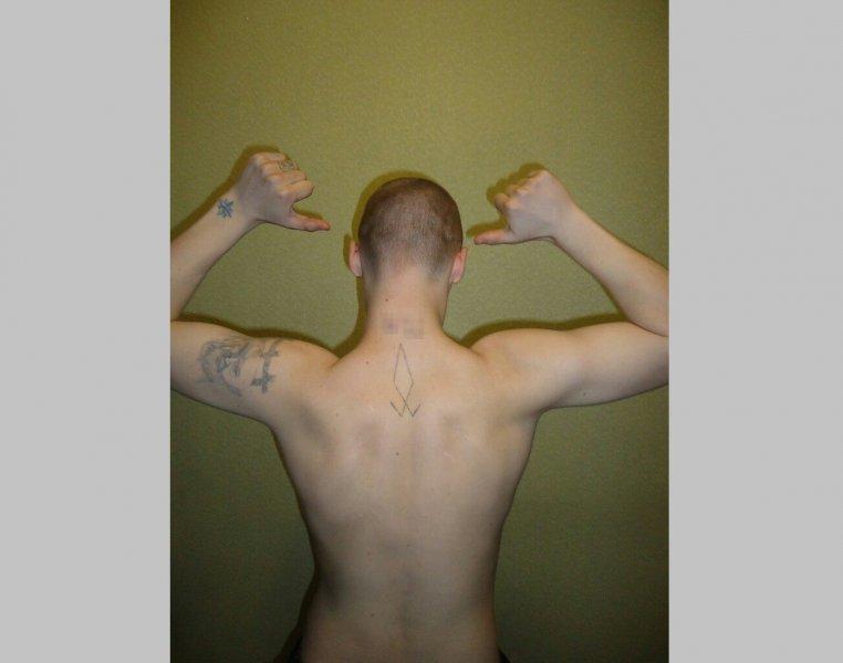 Новосибирец набил экстремистскую татуировку и попал под суд